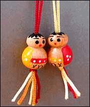 Effet mode d'origine japonaise, petits personnages qui ornaient les cheveux des petites filles, quel était leur nom ?