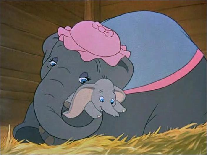 Dans quoi voyagent les animaux du cirque lorsque Jumbo, la maman de Dumbo, obtient enfin son bébé ?