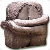 A la différence de Rodin, qui a représenté les amants sur le rocher, Brancusi les a sculptés dans le rocher. Cette sculpture, réalisée en plusieurs variantes, s'appelle...