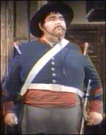 Le sergent Garcia, dont la grande occupation est de pourchasser Zorro, est, pour l'état civil :
