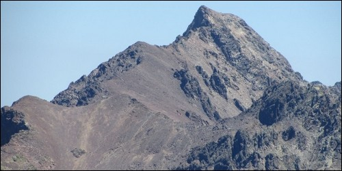 Comment s'appelle le plus haut sommet de Corse qui culmine à 2 706 m ?