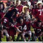 Dans l'épisode 11 saison 2, les filles se proposent de jouer au football américain pour aider les garçons, combien sont-elles ?