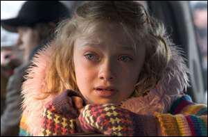 Avec quel célèbre acteur Dakota Fanning a-t-elle tourné dans ' La Guerre des mondes ' ?