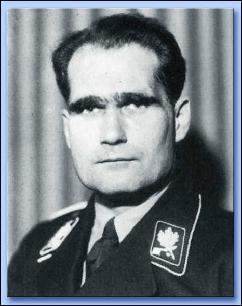 Participe activement à la rédaction des lois de Nuremberg