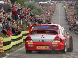 Quel pilote a remporté quatre championnats pilotes et un championnat constructeurs avec une Mitsubishi Lancer (le seul titre constructeurs de Mitsubishi en WRC) ?