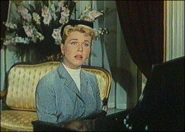Dans quel film assiste-t-on à la scène émouvante où Doris Day chante ''Que Sera Sera'' pour avertir son fils de sa présence ?