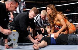 A qui Kane a-t-il porté un Tombstone Piledriver après le match ?