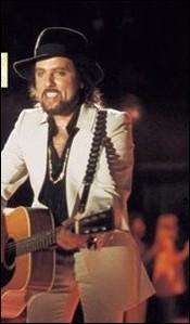 Coluche disait de lui : 'Il a choisi entre le, talent et le chapeau de Bob Dylan' ... . .