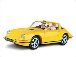 Quel héros de bandes dessinées se déplace en Porsche 911 jaune ?