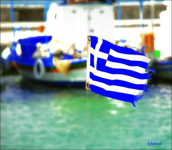 En cumulant l'effacement de 53, 5% de sa dette et le prêt européen, à combien se chiffre le plan d'aide à la Grèce trouvé le 21 février ?