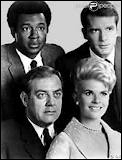 Dans ''L'Homme de fer'' , le policier Robert Dacier est blessé par balle et se retrouve avec : un blanc, une blonde, un noir et...