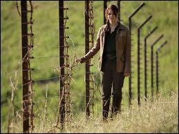 Qu'est-ce que Katniss est en train de faire ?