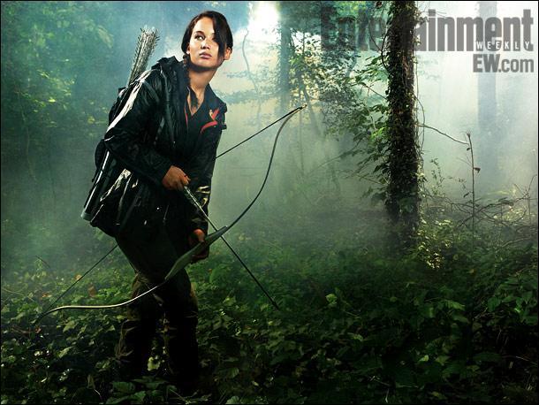 Que représente la broche portée par Katniss durant les Hunger Games ?