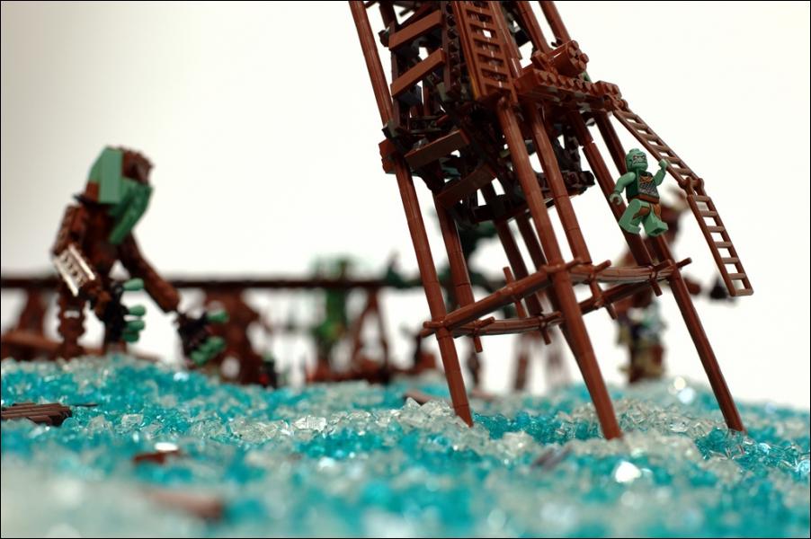 Durant cette rude bataille, Frodon est attiré dans un piège par Gollum ...