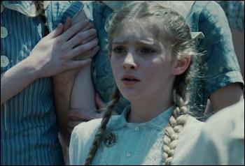 Quel aliment laisse la petite soeur de Katniss pour elle ?