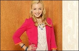 Comment s'appelle la jolie blonde de 13 ans qui est l'aînée de la famille ?