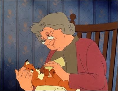 Quelle fermière recueille Rox, le renardeau orphelin de 'Rox et Rouky' ?