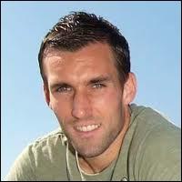 Dans quel club étranger a évolué Anthony Reveillère en 2003 ?