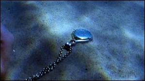 A qui est le collier trouvé dans la grotte de Mako ?