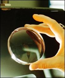 Comment peut-on reconnaître un verre de lunettes convergent ?
