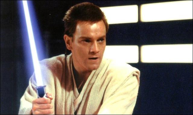 Quel(le) Chevalier(ère) Jedi a pris Anakin sous son aile, après la mort de Qui-Gon Jinn, afin d'en faire également un Chevalier Jedi ?