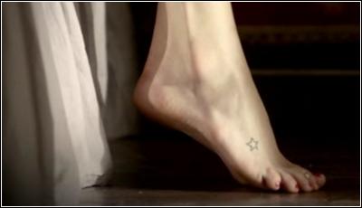 À qui appartient ce tatouage représentant une étoile ? (On le voit dans la saison 1)