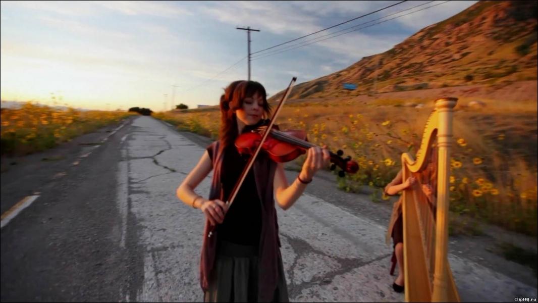 Quelle musique de Yiruma, interprète-t-elle auprès d'une joueuse de harpe ?