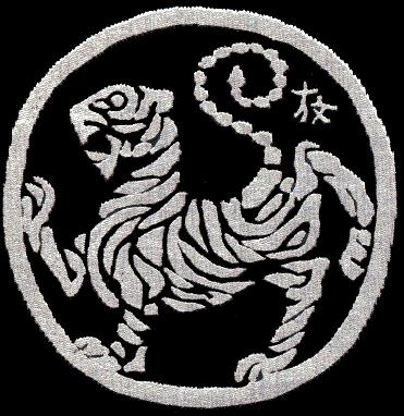 Quelle est la signification du symbole du karaté  Shotokan  s'appelant le  Tora no maki