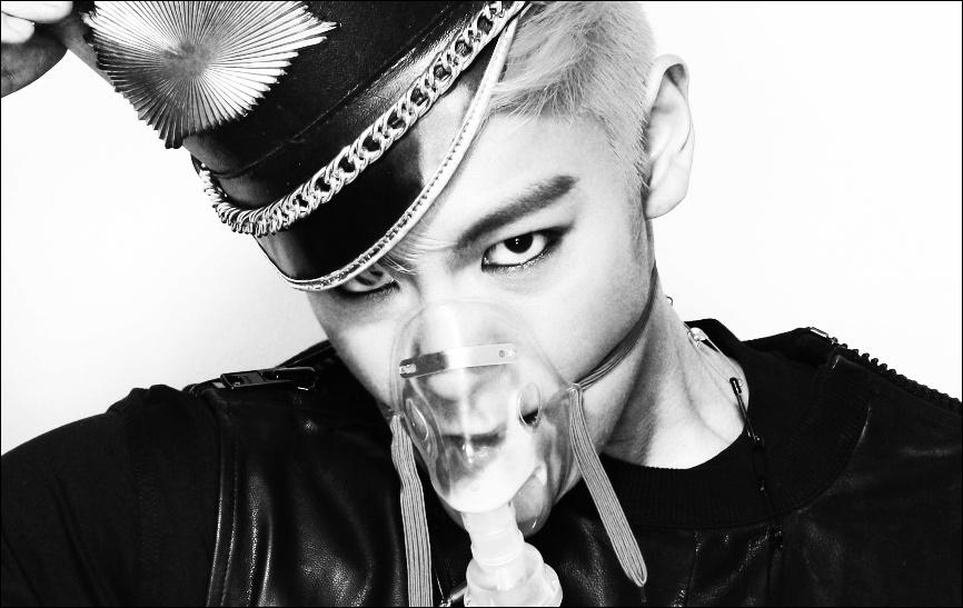 Quelle est la couleur des cheveux de T. O. P dans le MV de  Fantastic Baby  ?