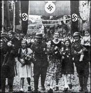 Quelle nouvelle région à prédominance germanique revendique-t-il ensuite , provoquant ainsi une grave crise internationale ?