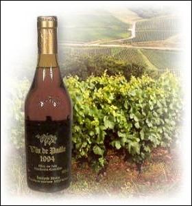 Quelle est la particularité du vin de paille, vin liquoreux produit principalement dans le Jura ?