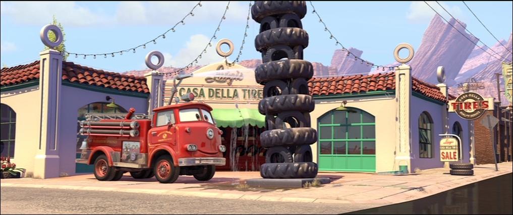 A quelle tour, la pile de pneus de Luigi fait-elle hommage ?