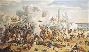 Déjouant la surveillance de la flotte anglaise en Méditerranée, l'armada napoléonienne accoste sur les rivages de l'Egypte sans difficulté. Par la prise de quelle prestigieuse cité, connu dans l'antiquité pour son phare et sa bibliothèque, commence la conquête de l'Egypte (2 juillet 1798) ?