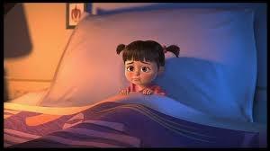 A la fin du film  Monstres et Cie , lorsque Sulli tient les jouets de Bouh, quels célèbres personnages des studios Pixar peut-on apercevoir ?