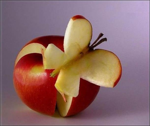 Magnifique n'est-ce pas ? On distingue nettement un papillon aux ailes fermées posé sur une pomme. Vrai ou faux ?