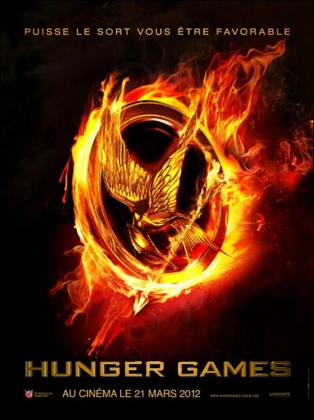 Comment s'appelle l'oiseau qui est représenté sur la broche de Katniss ?