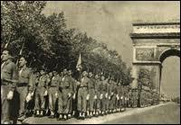 Alors qu'elles constituaient près de 60 % des troupes françaises de libération, quelle a été  la récompense  des troupes coloniales lors du défilé de la libération ?