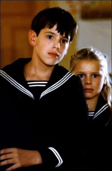 Dernier film de Bergman mettant en scène deux enfants confrontés à la tyrannie d'un beau-père. Le film s'appelle :