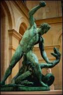 Pour son onzième travail, quelle créature reptilienne à plusieurs têtes gardait le jardin d'où Héraclès devait rapporter les pommes d'or ?