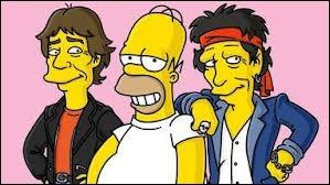 Avec quel groupe Homer pose-t-il ?
