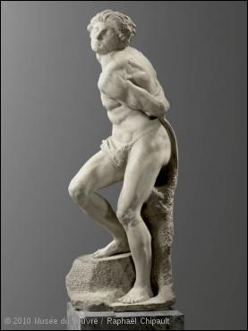 Quel sculpteur et artiste de la Renaissance italienne réalisa ce couple d'esclaves captifs, pour orner le futur tombeau du pape Jules II ?