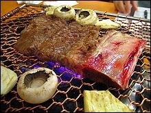 Cette côte de boeuf marinée et grillée au charbon se nomme  Galbi , dans quel restaurant allez-vous manger ?