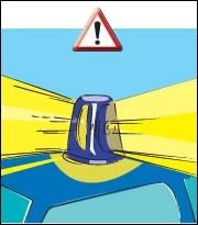 Un véhicule d'urgence a le droit de passer au feu rouge.