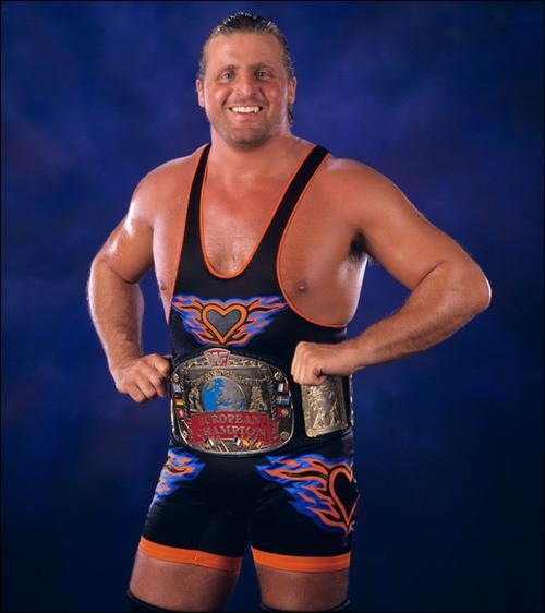 Frère du légendaire Bret Hart et fils de Stu Hart, décédé durant un match, qui est ce lutteur ?