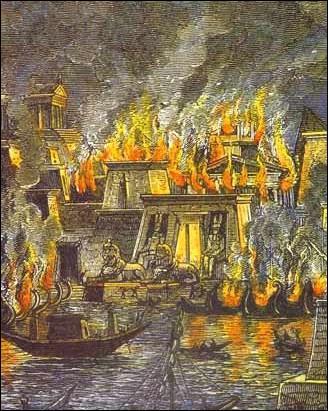 Mécontent de cette situation, Ptolémée attise la colère des Alexandrins contre Cléopâtre et César, ce qui entraine une révolte. Pour éviter que ses bateaux ne tombent aux mains des ennemis, César les brûle, mais l'incendie se répand et détruit en grande partie un bâtiment inestimable. Lequel ?