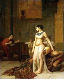Selon la légende, dans quoi Cléopâtre s'est-elle cachée pour pénétrer dans le palais royal d'Alexandrie afin d'y rencontrer César pour la première fois ?