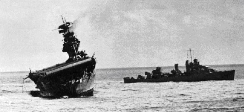 Une île américaine nommée AF par les japonais, plus d'eau potable sur cette île. Les japonais en perdirent 4, les américains 1. Cette bataille, à mi-distance, a été le point d'arrêt des japonais.Quelle est cette bataille ?