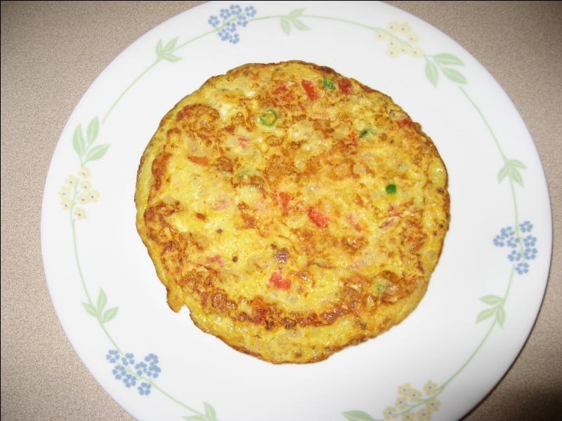 Que faut-il ajouter à une omelette pour la rendre plus moelleuse ?