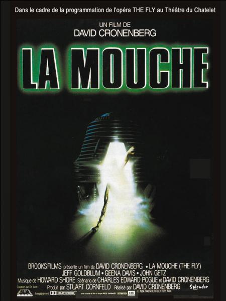 Dans le film  La Mouche , comment le biologiste Seth Brundle crée-t-il le mutant entre un homme et une mouche ?