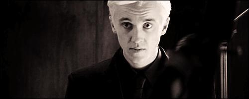 De quelle couleur sont les yeux de Malfoy ?